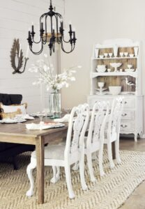 Slightly Coastal-reveal-dining-room-black-chandelier-white-wood-shiplap-beach-fixer-upper-style-settee-36-2